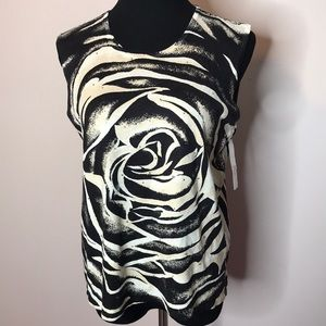 Rafael knits silk blend top with embellishments.